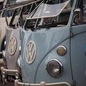 Volkswagen Kombi minibuses are lined up
