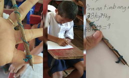 """สู้ชีวิต """"นักเรียนไม่มีเครื่องเขียน"""" เลยเอาเศษไม้กับหนังยางมาทำเป็นปากกา"""