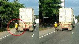 หวาดเสียวแทน วิจารณ์ยับหนุ่มขี่มอเตอร์ไซด์ ใช้มือเกาะรถบรรทุก