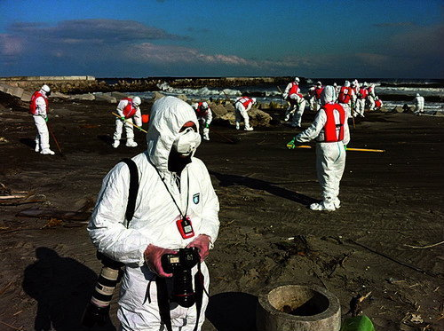 Photographer Jeremy Sutton-Hibbert photographing in the 20km nuclear exclusion zone around Fukushima Daiichi nuclear plant, in, Japan, on Monday 27 February 2012. .