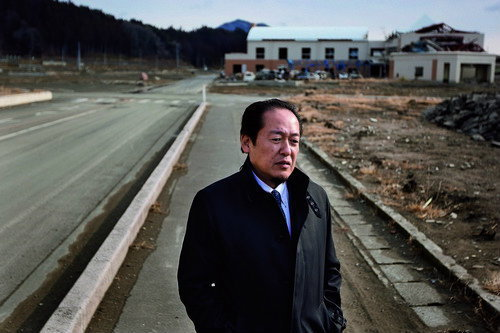 Futoshi Toba, Mayor of Rikuzentakatata city, stands within the desolated landscape where his city once stood, before it was destroyed by the March 11th 2011 tsunami, in Rikuzentakatata, in Tohoku area, Japan, on Monday 23 January 2012.