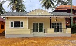 บ้านชั้นเดียวสไตล์คอจเทจ หลังคาทรงโค้งสวยงาม 2 ห้องนอน 1 ห้องน้ำ พร้อมระเบียงหน้าบ้าน งบก่อสร้าง 890,000 บาท