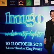 Hugo under city lights