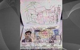 """คุณพ่อชาวจีนซวย หลังลูกน้อยโชว์ลายเส้นบนหน้า """"พาสปอร์ต"""""""
