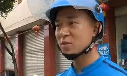 สาวจีนไข้ขึ้นสูงกลางดึก รอดตายเพราะพนักงานส่งอาหารช่วยพาไปส่งรพ.