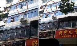 สุดระทึก แม่อุ้มลูกโยนลงจากหน้าต่างตึกชั้น 5 หนีตายไฟไหม้ห้อง