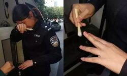 เจ็บจนร้องไห้ ตำรวจหญิงจีนรีบช่วยคน ถูกกัดนิ้วมือเกือบขาด