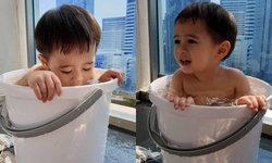 """""""น้องสายฟ้า"""" อวดวิธีคลายร้อน เย็นชุ่มฉ่ำในถังน้ำใบจิ๋ว"""
