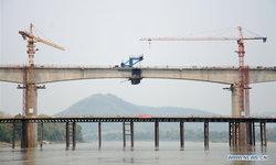 เชื่อมต่อสำเร็จ สะพานทางรถไฟจีน-ลาว ข้ามแม่น้ำโขงแห่งแรก
