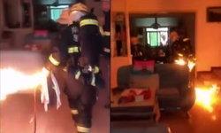 ต้องเสี่ยง! จนท.ดับเพลิงจีนคว้าถังแก๊สไฟลุกวิ่งลงตึก ช่วยเจ้าของบ้านพ้นภัย