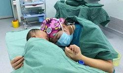 นางฟ้าชุดเขียว พยาบาลสาวสุดอ่อนโยน ปลอบเด็กชายตื่นกลัวก่อนการผ่าตัด