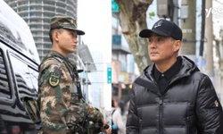 ตรุษจีน 2562: ตำรวจหนุ่มไม่ได้กลับบ้าน ยืนสบตากับพ่อเงียบๆ คนละฝั่งถนน