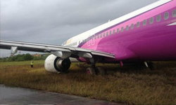 เครื่องบินนกแอร์ ไถลออกนอกรันเวย์สนามบินตรัง!!
