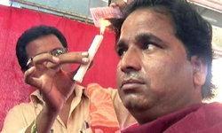 หนุ่มอินเดียมากฝีมือใช้เทียนไขตัดผม  ลูกค้าถูกใจแห่ตัดไม่ขาดสาย