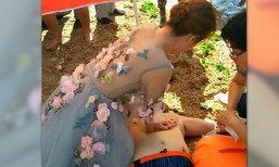 นางฟ้าเมืองจีน สาวใส่ชุดวิวาห์ ช่วยยื้อชีวิตหนุ่มหัวใจวาย