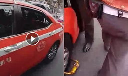 คลิปตำรวจล็อกล้อแท็กซี่  ชาวเน็ตข้องใจ เหมือนบังคับให้จ่ายค่าปรับทันที