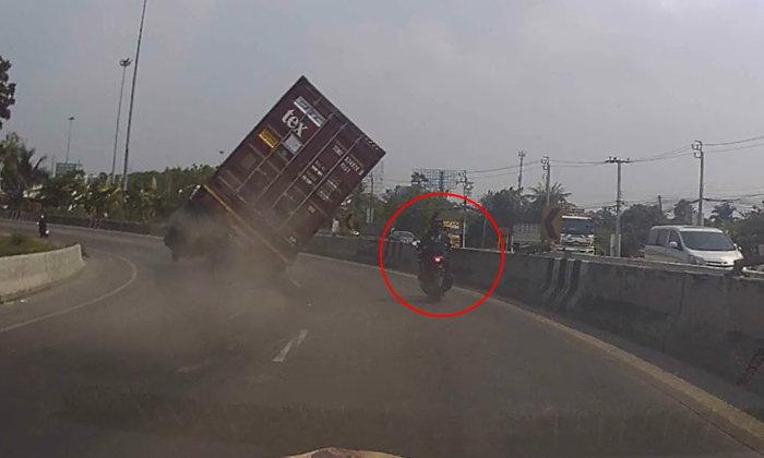 เผยคลิปอุทาหรณ์  รถบรรทุกซิ่งเข้าโค้ง ตู้คอนเทนเนอร์ล้มคว่ำ หวิดทับรถชาวบ้าน