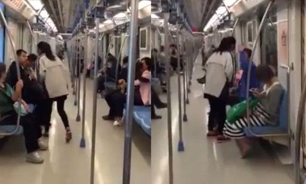 สาวจีนสุดเพี้ยน เดินถุยน้ำลายใส่คนทั้งขบวนรถไฟฟ้า