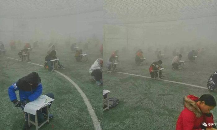 วิจารณ์สนั่น! รร.ในจีนจัดให้นักเรียนกว่า 400 คน สอบกลางสนามท่ามกลางหมอกควันหนา