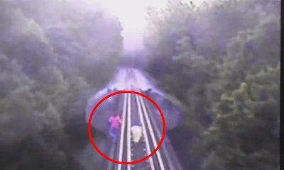 ระทึก! คลิปสองสาววิ่งหนีรถไฟถูกทับร่าง