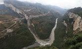 จีนเปิดสะพานยักษ์ข้ามหุบเขาเชื่อม 3 มณฑล ย่นเวลาเดินทาง 2 ชั่วโมงครึ่ง เหลือ 1 นาที