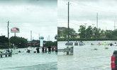 ภาพประทับใจ โซ่มนุษย์คนเท็กซัสร่วมใจช่วยชายติดในรถจมน้ำท่วม