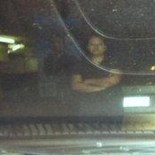ภาพถ่ายหมอมุก ยืนหน้ารถ