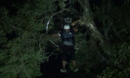"""ร่อนลงผิดจุด """"พารามอเตอร์"""" ค้างบนยอดไม้ 20 เมตร นักบินหมดแรงหวิดร่วง"""
