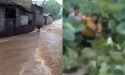 นาทีชีวิต เด็กนักเรียนจีนถูกน้ำท่วมพัดหาย เคราะห์ดีพลเมืองตามช่วยทัน