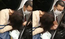 """เต็มตา! หนุ่มญี่ปุ่นหยิบมือถือ """"ฟาดหัว"""" สาวขี้เซาบนรถไฟ หลังหลับแล้วหัวพิงไหล่"""