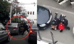 ระทึกอย่างกับในหนัง! ตำรวจจีนติดอาวุธจับกุมผู้ต้องสงสัยกลางถนน