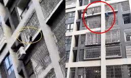 ชายจีนใจกล้า ปีนตึกมือเปล่า ช่วยเด็ก 4 ขวบ ติดลูกกรงหน้าต่างชั้น 6