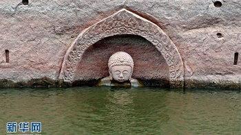 ฮือฮา! จีนพบเศียรพระพุทธรูปโบราณโผล่ในอ่างเก็บน้ำ หลังน้ำลด