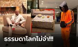 """ขีดสุดของความรวย! """"ฟลอยด์"""" อดีตกำปั้นโลกโชว์โต๊ะกาแฟที่ทำจากกองเงินมหาศาล (ภาพ)"""