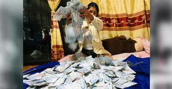 เงินแสนดีใจ! สาวค้าไก่สดเก็บแบงก์ 50 ปลายปีได้เงิน 140,000 บาท