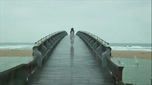 Rina Akiyama  crosses the bridge