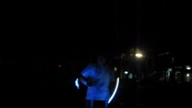 double nunchaku on the beach night