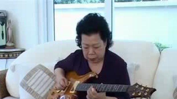 Grandma Rawks_ Guitar ownage  by  sia.co.th