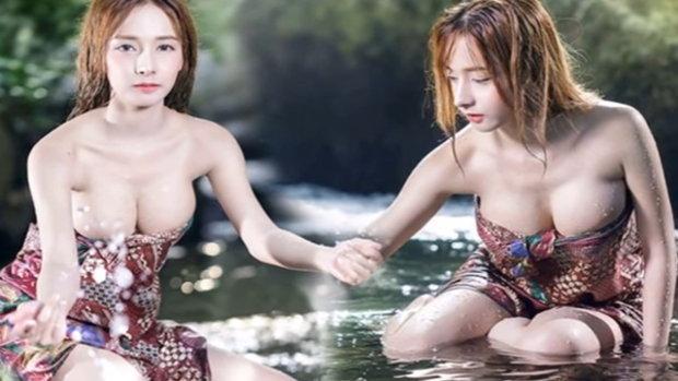 นุ่งผ้าถุงอาบน้ำกลางขุนเขา สาวไทย เซ็กซี่ ดังไกลถึงไต้หวัน
