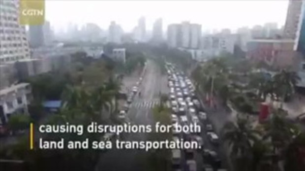 อัมพาตทั้งเมือง หมอกหนาทำรถติดยาวที่ท่าเรือไห่หนานกว่าหมื่นคัน