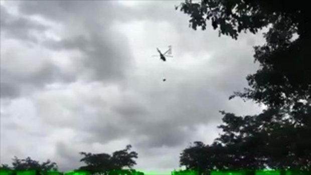 เฮลิคอปเตอร์นำเครื่องเจาะ 1.8 ตัน บินขึ้นสมทบเพิ่มเติมบนดอยผาหมี