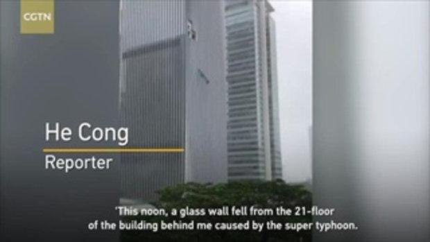 ไต้ฝุ่นมังคุด ซัดกระจกตึกสูงร่วงพื้น นักข่าวจีนสะดุ้งหนีสุดตัว