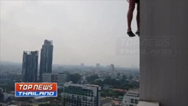 สยอง! ชายผูกคอตายจากดาดฟ้าคอนโดสูง 31 ชั้นริมหาดพัทยา ร่างห้อยต่องแต่งข้างตึก