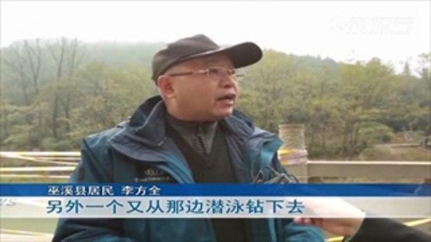 ชายจีนน้ำใจงาม กระโดดลงแม่น้ำช่วยหญิงติดอยู่ในรถรอดชีวิต