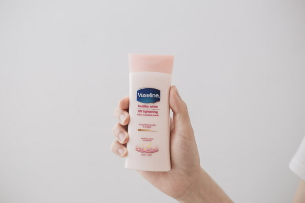Front of Vaseline healthy white body lotion bottle