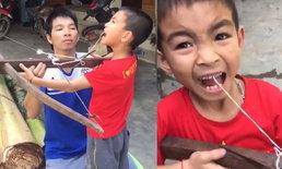 คลิปถอนฟัน ด้วยวิธีสุดเสียว เมื่อพ่อปิ๊งไอเดียผูกฟันลูกไว้กับหน้าไม้ หลุดไม่หลุด!