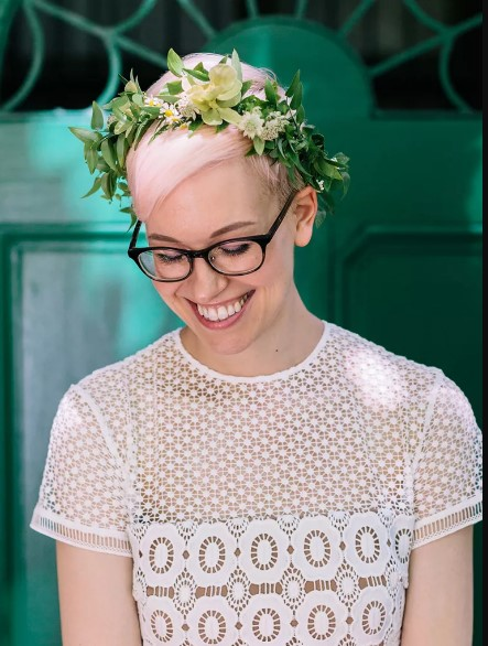 Pink pixie cut with flower crown wedding day hairstyle
